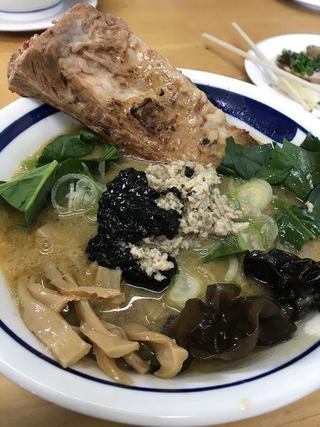 「豚骨 胡麻~ユ c」@MENYA 食い味の道有楽の写真