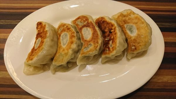 「焼き餃子(5個) 450円+消費税」@王記酒家の写真