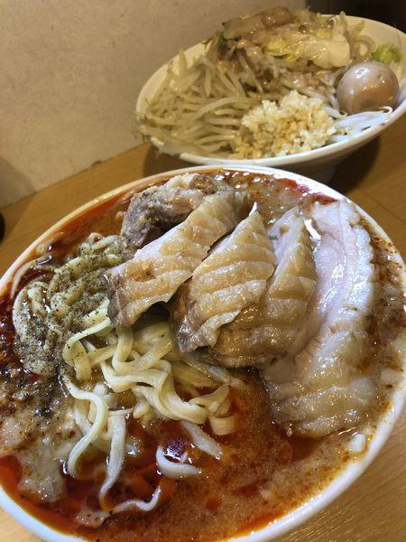 「辛くない辛麺小豚入り+味玉」@豚星。の写真