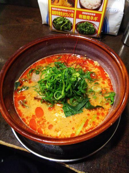 「赤辛 担々麺・有機青ネギトッピング」@光麺 原宿店の写真