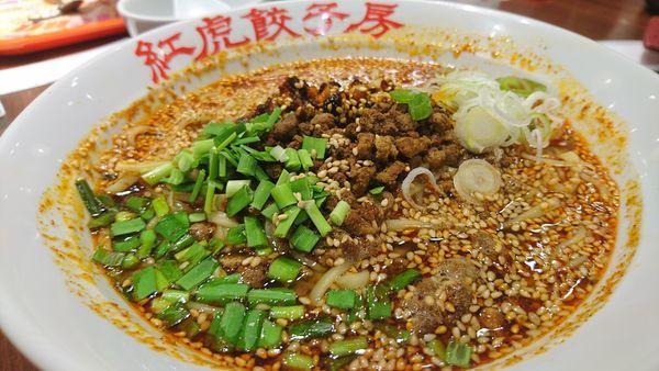 「超辣タンタン麺、半炒飯、大餃子」@紅虎餃子房 ヴィーナスフォート店の写真