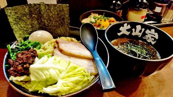 「GW限定/黒ごま坦々つけ麺ゴールド+焼きチャーシュー飯黄身の」@ラーメン 大山家 昭島店の写真
