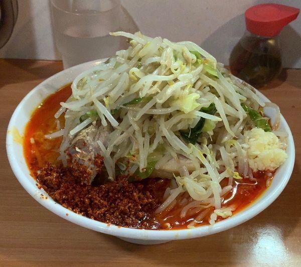「辛麺小 ニンニク少なめ ホアジャオ 辛味玉」@豚星。の写真